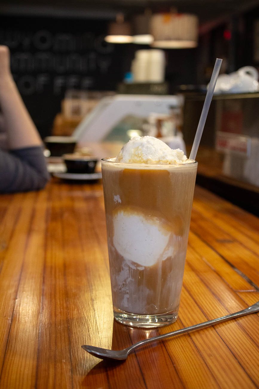 Cold brew float with gelato sitting on their bar, which is made from refurbished bowling alley lanes / Image: Katie Robinson,Cincinnati Refined // Published: 3.18.19