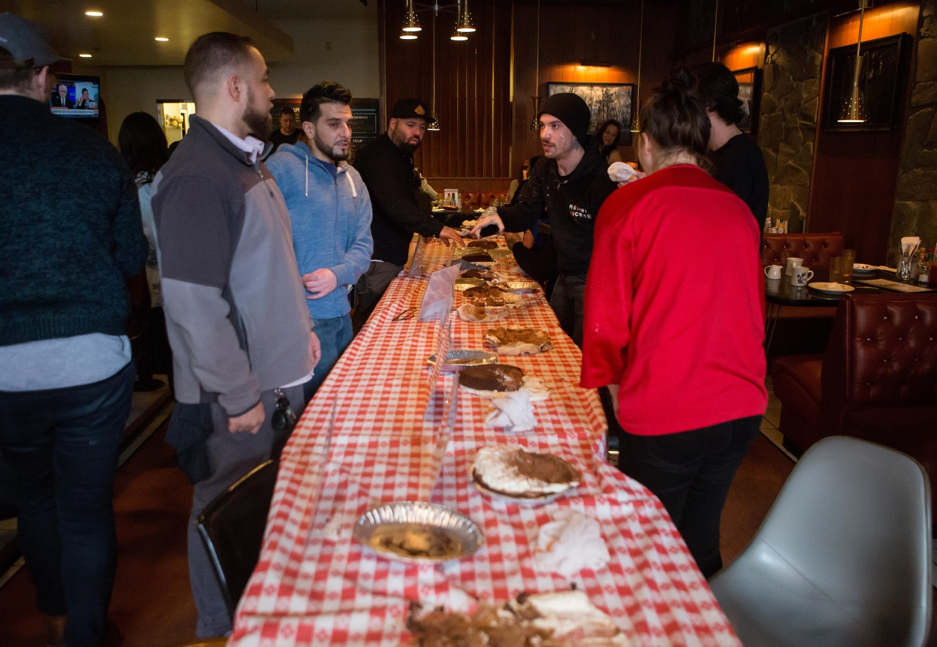 Pie lays scattered around the table after the second annual Pi Day Pie Eating Contest comes to a close at Lost Lake Cafe. (Sy Bean / Seattle Refined)