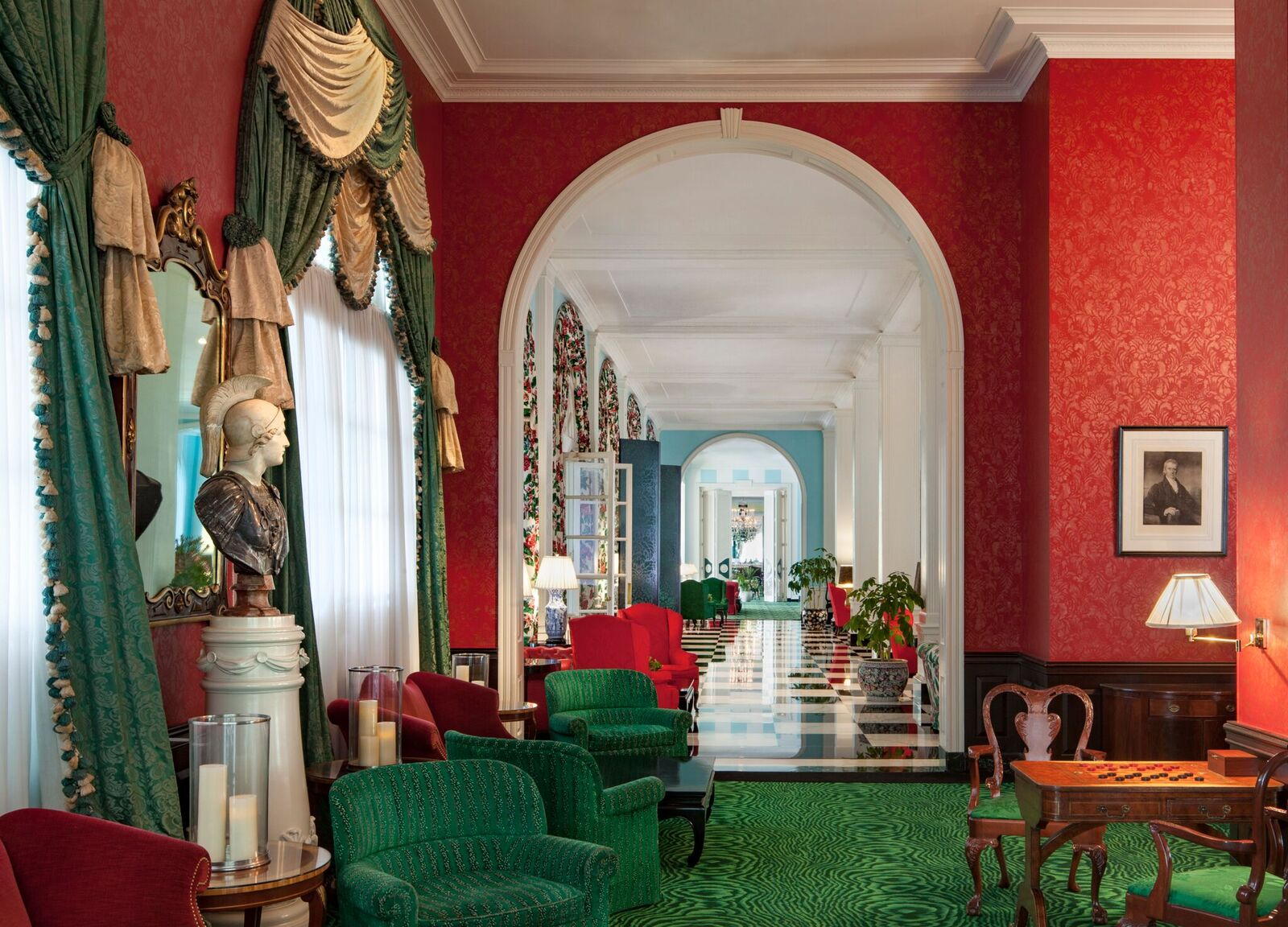 The lobby bar features red hand-painted walls as well as views into the trellis room.{ }(Image: Courtesy The Greenbrier)
