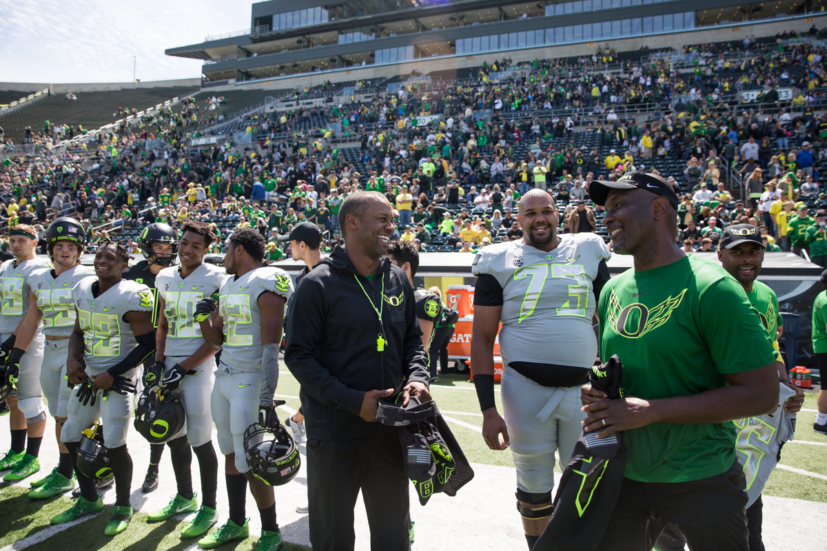 New Oregon Ducks Head Coach Willie Taggart shares a laugh with an assistant coach prior to the jersey exchange with military service members. The 2017 Oregon Ducks Spring Game provided fans their first look at the team under new Head Coach Willie Taggart's direction.  Team Free defeated Team Brave 34-11 on a sunny day at Autzen Stadium in Eugene, Oregon.  Photo by Austin Hicks, Oregon News Lab