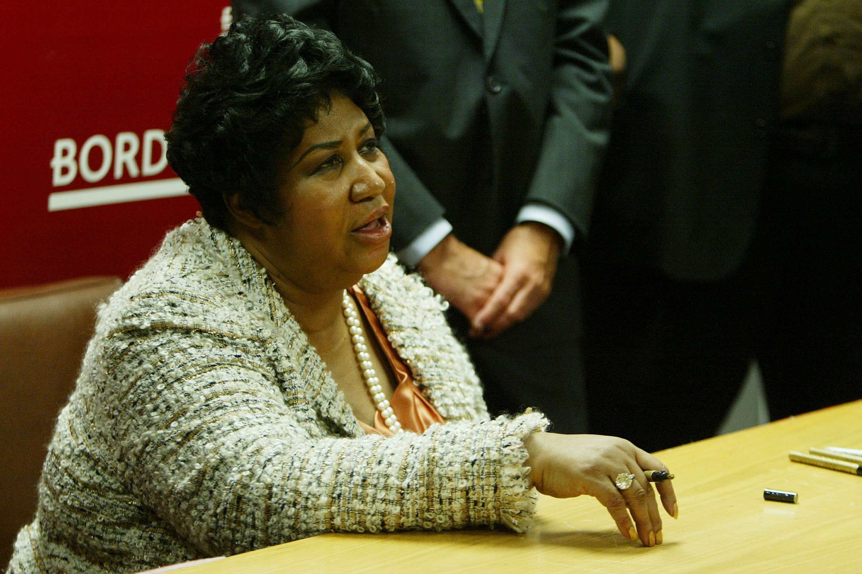 Aretha Franklin signs copies of her first Christmas CD 'This Christmas Aretha' at Borders in Washington DC on Oct. 20 2008. (Credit: Carrie Devorah / WENN)