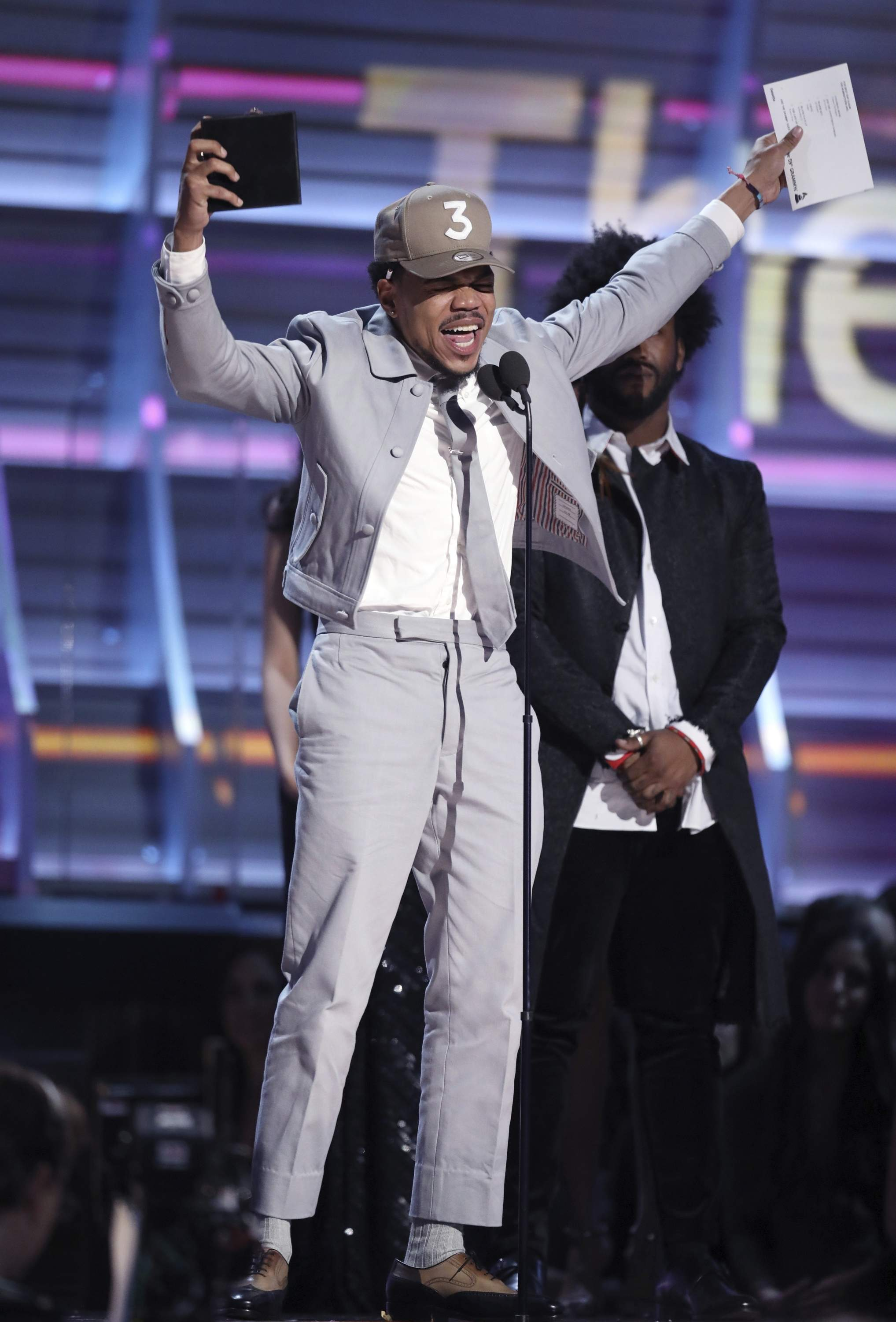Chance The Rapper accepts the award for best rap album for 'Coloring Book' at the 59th annual Grammy Awards on Sunday, Feb. 12, 2017, in Los Angeles. THE ASSOCIATED PRESS