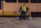TriMet using flames to melt icy MAX line track at scene of derailment - KATU photo.PNG