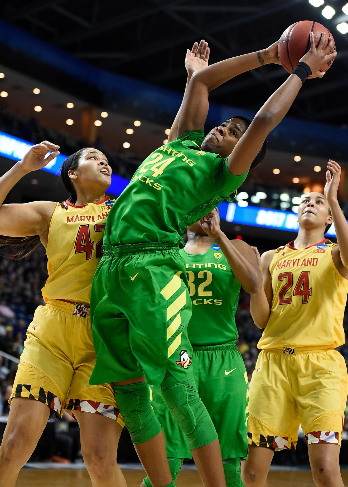 Oregon's Ruthy Hebard, center, pulls down an offensive rebound as Maryland's Brionna Jones, left, defends, during the first half of a regional semifinal game in the NCAA women's college basketball tournament, Saturday, March 25, 2017, in Bridgeport, Conn. (AP Photo/Jessica Hill)