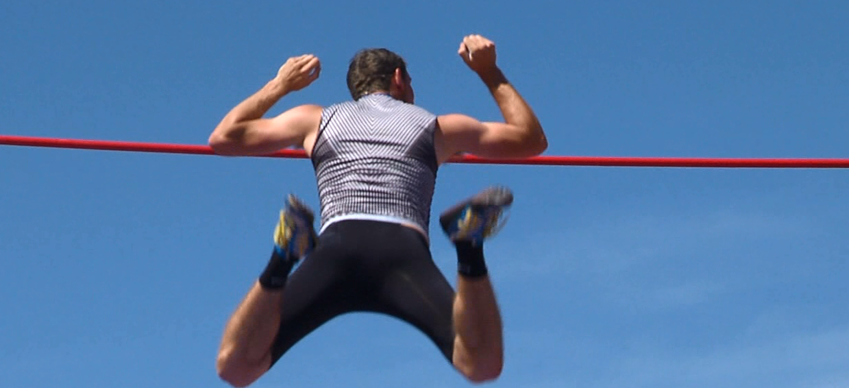 UNK's Bailey Stapleman clears the bar during the pole vault. Stapleman placed 1st. (NTV News)