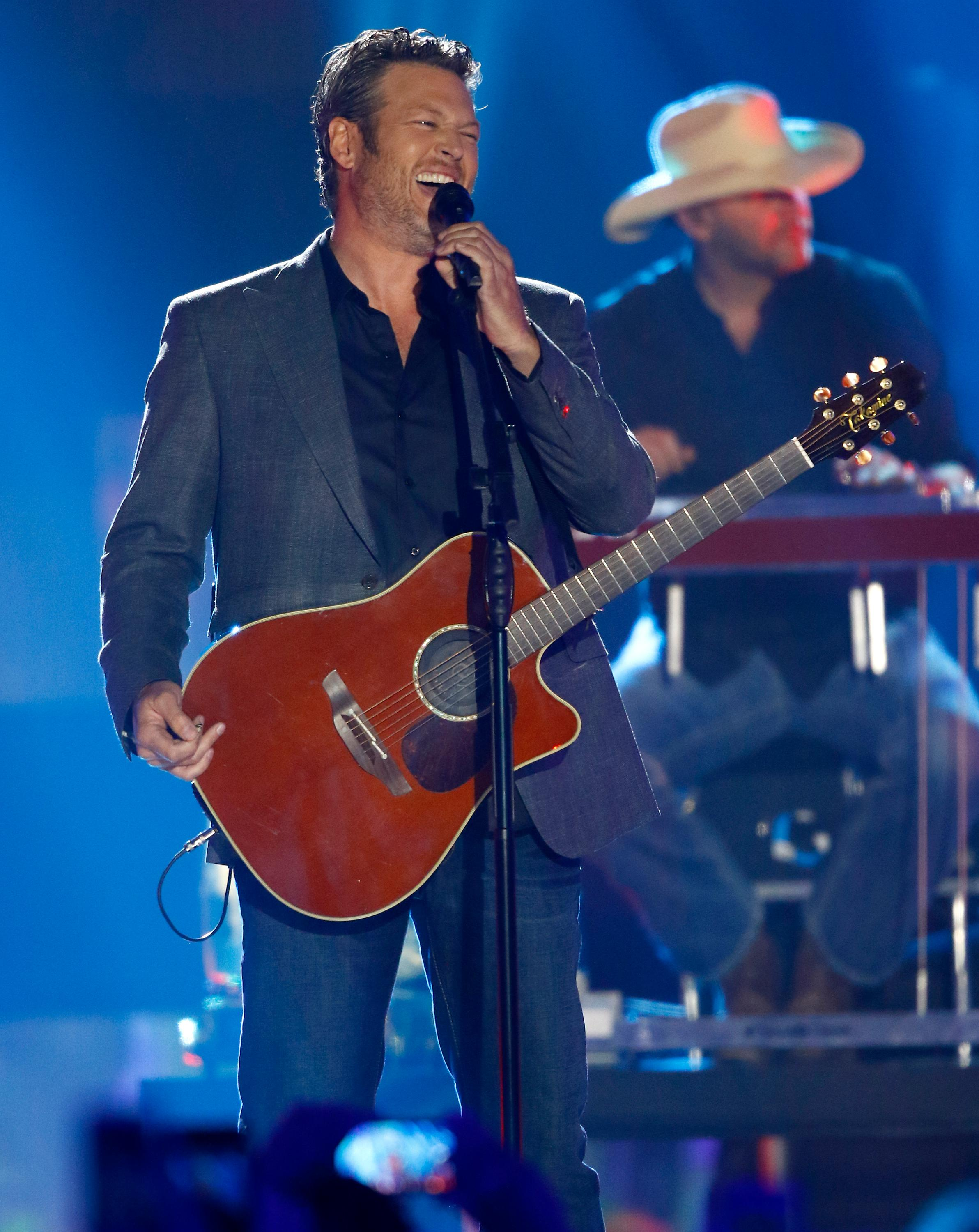 "FILE - In this June 7, 2017, file photo, Blake Shelton performs ""Every Time I Hear that Song"" at the CMT Music Awards at Music City Center in Nashville, Tenn. Shelton, Beyonce, Barbra Streisand and Oprah Winfrey will headline a one-hour benefit telethon to benefit Hurricane Harvey victims that will be simulcast Sept. 12 on ABC, CBS, NBC, Fox and CMT. (Photo by Wade Payne/Invision/AP, File)"