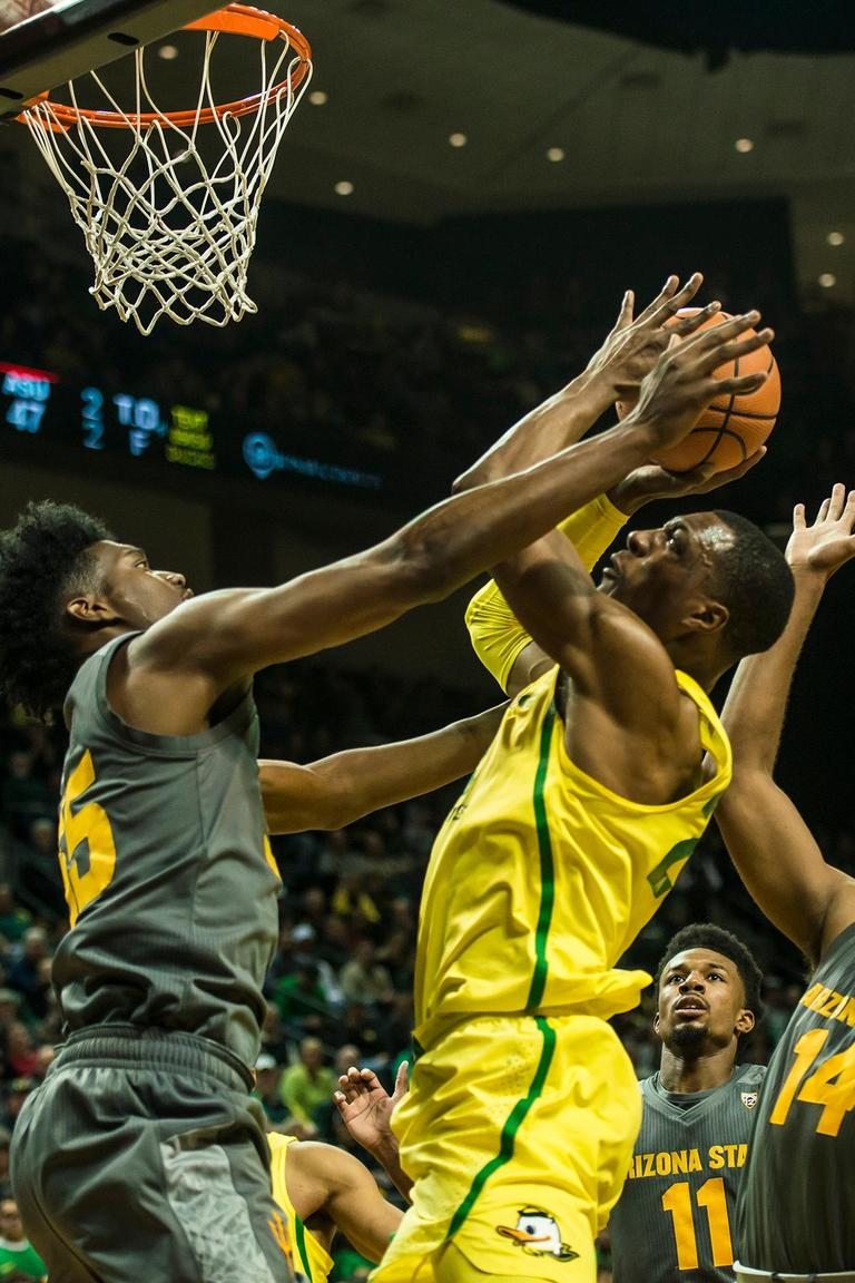 Oregon's MiKyle McIntosh goes for a layup against ASU defendaers, Thursday at Matthew Knight Arena. Oregon defeated ASU 75-68 to improve their season record to 18-10 (8-7 PAC-12). The Ducks face off against fourteenth ranked Arizona for their final home game of the season at Matthew Knight Arena on Saturday. (Photo by Colin Houck)