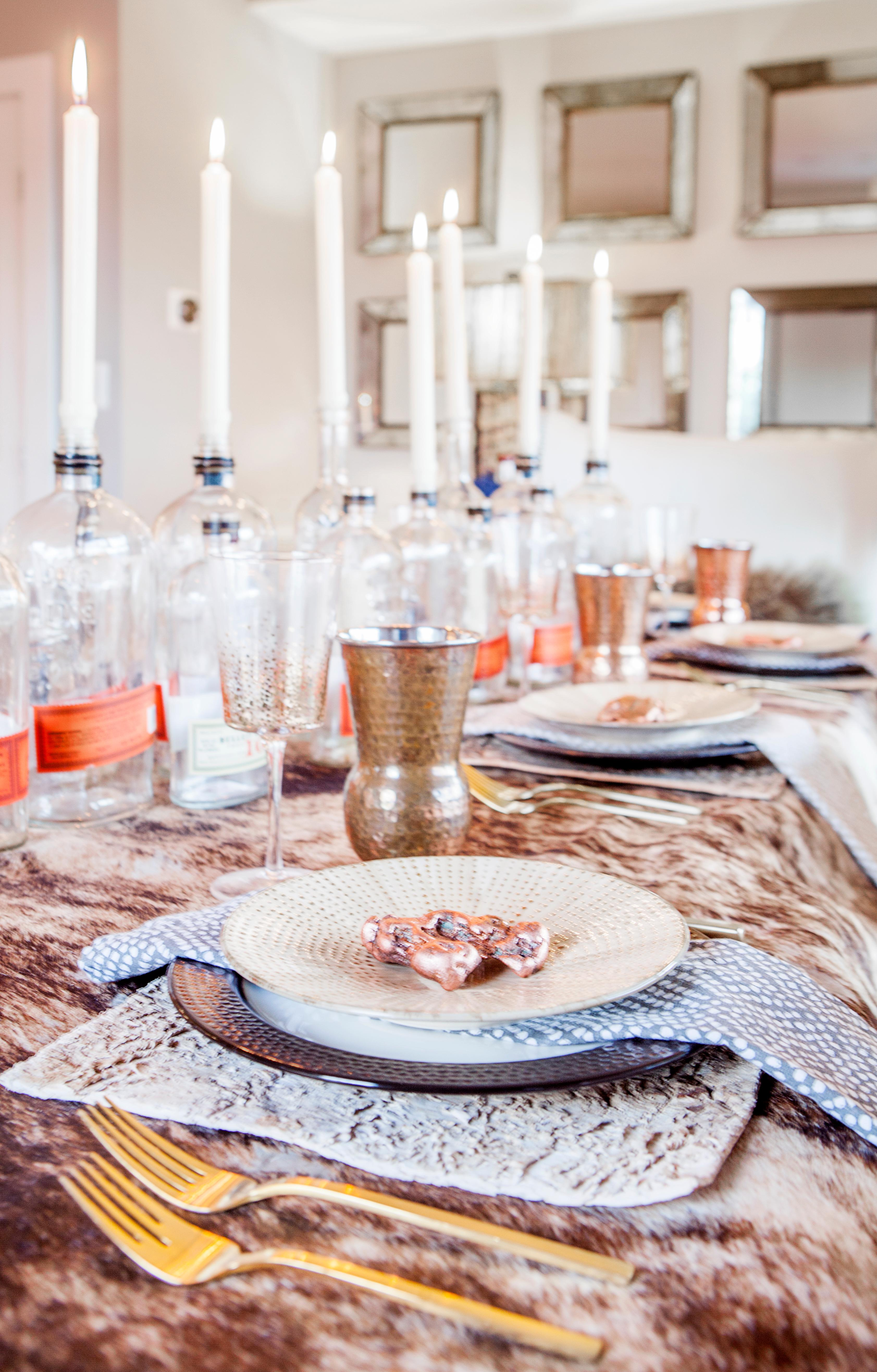 I kept the color palette simple to keep the table feeling manly, and really let the orange labels of the bottles pop. The way to make this table interesting is through layering different textures together. This table would be great for a whiskey tasting party, your man's birthday, or even Fathers Day. (Image: Ashley Hafstead)