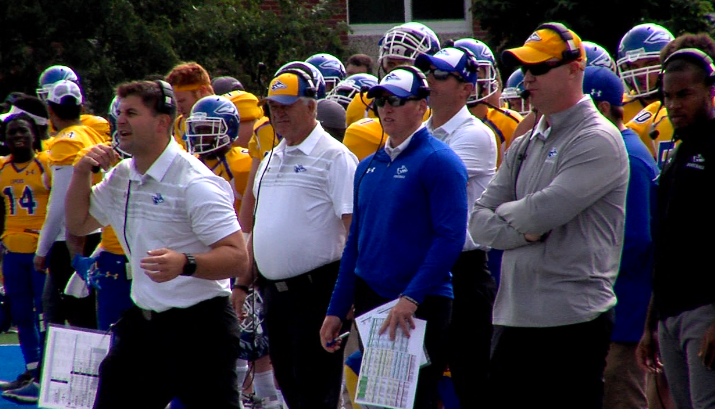 UNK defensive coordinator Scott Lewis (left) and head coach Josh Lynn (right) watch on as Lewis calls in the defense, Sept. 16, 2017 (KHGI)