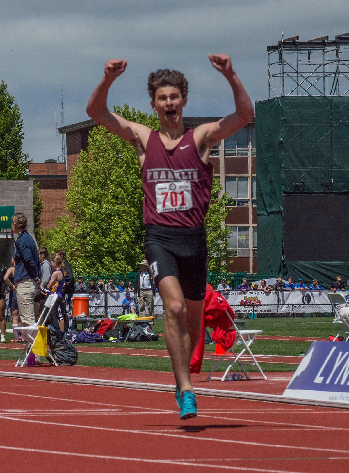 Henry Mong of Franklin High School celebrates victory as he crosses the finish line of the 6A Boys 1500 Meter race. Mong wins with a time of 3:50.52 at the OSAA Track and Field Championsips held at Hayward Field. Photo by Emily Gonzalez, Oregon News Lab.