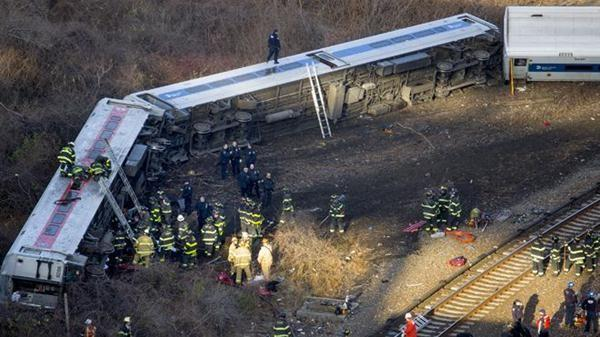 First responders gather at the derailment of a Metro-North passenger train in the Bronx borough of New York.