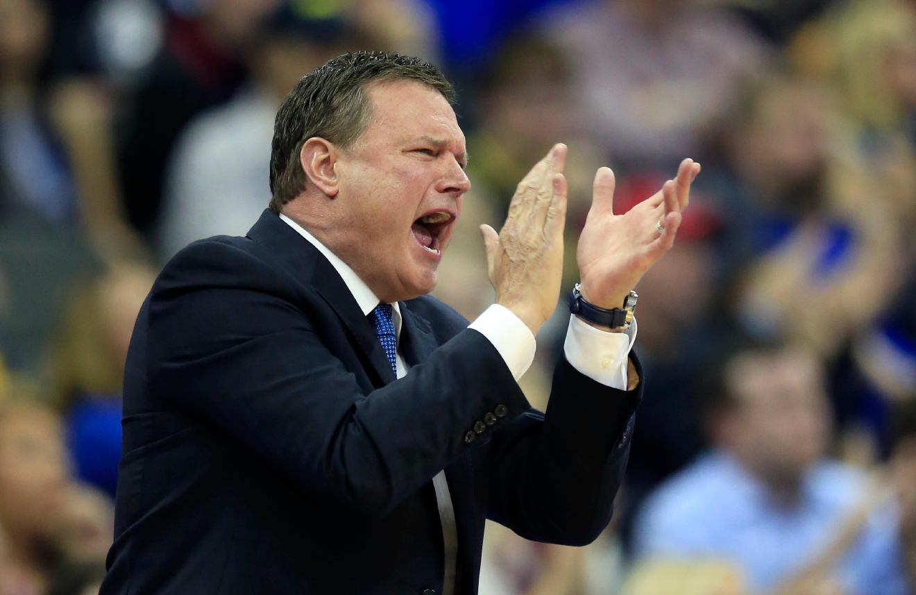 Kansas coach Bill Self applauds his team during the first half of a regional semifinal against Purdue in the NCAA men's college basketball tournament, Thursday, March 23, 2017, in Kansas City, Mo. (AP Photo/Orlin Wagner)