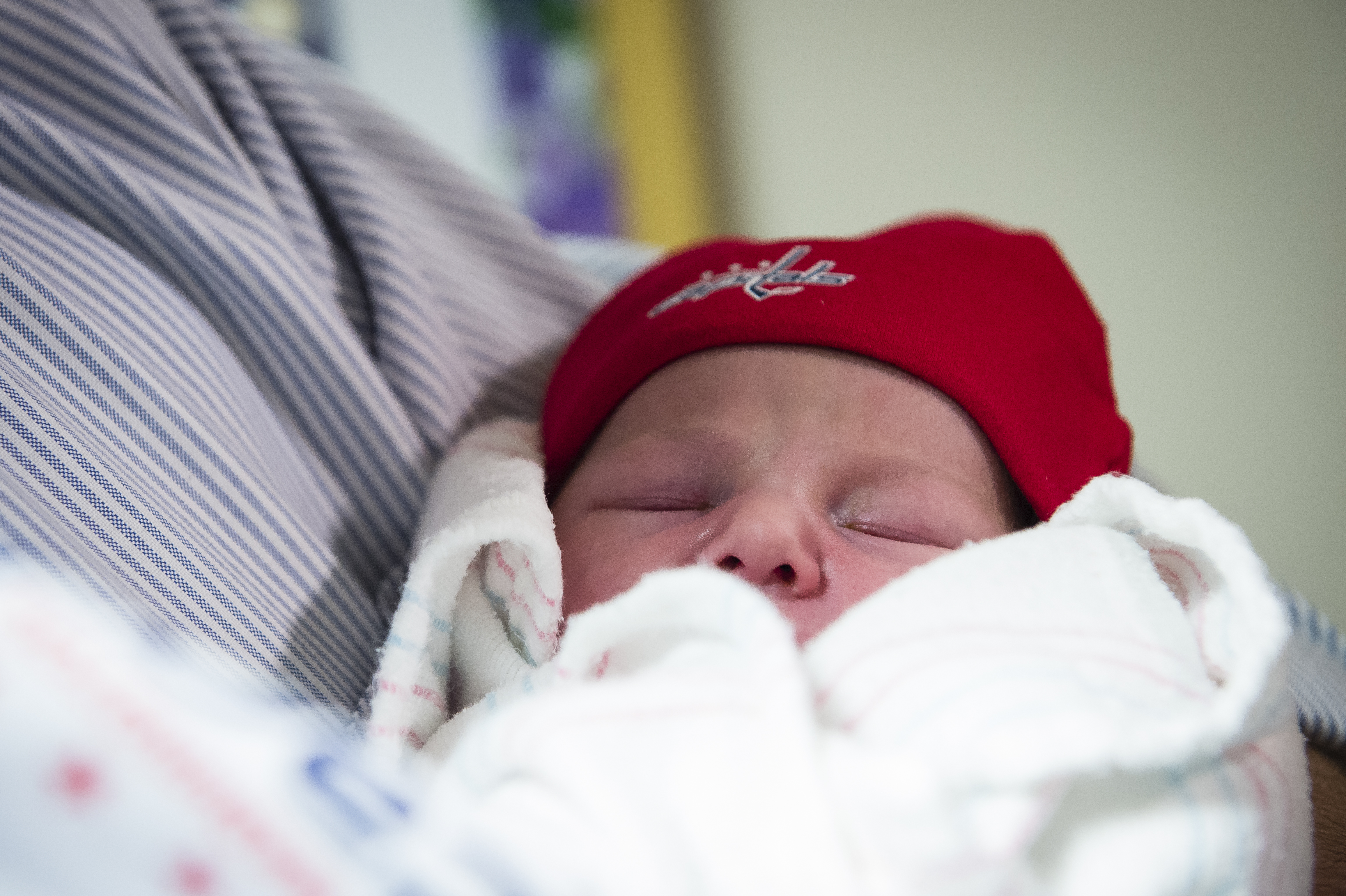 "Meet Mary Elizabeth York Allen, the Caps newest (and possibly cutest!) fan! From Wednesday, April 12 through whenever the Caps playoff run ends, all babies born at MedStar Washington Hospital Center and MedStar Georgetown University Hospital will receive a complimentary Washington Capitals package including a blanket, hat and gift for the mother. ""Milly"" was born yesterday and is the first Caps Playoff Baby. Her dad, a huge Caps fan, was pretty syked about the free playoff tickets his newborn bundle of joy garnered him, and even said he would have considered naming her after a Caps player had she been a boy. Fans are sharing photos of their newborns by using the #CapsPlayoffBaby hashtag on social media platforms, so check that out if you need a smile today! Congrats to all the new mamas and papas out there and we hope you keep posting pics of your cuties in their Caps gear! (Photo by Patrick McDermott for the Washington Capitals)"