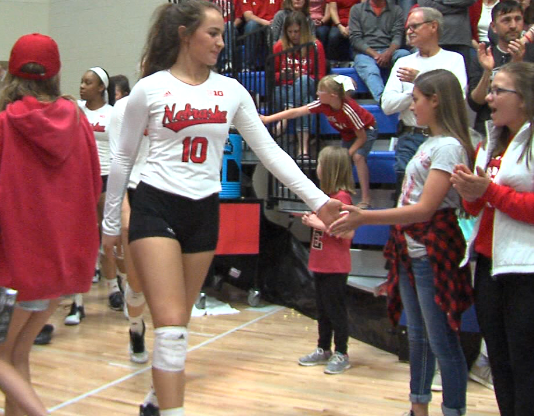 Nebraska's Hunter Atherton (10) high fives fans as the Huskers come out to the Kearney (Neb.) High School court for a spring match versus Colorado State (KHGI)<p></p>