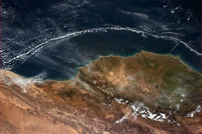 Very strange cloud pattern off Morocco's coast. Like Marrakesh has a force field.  (Photo & Caption: Col. Chris Hadfield, NASA)