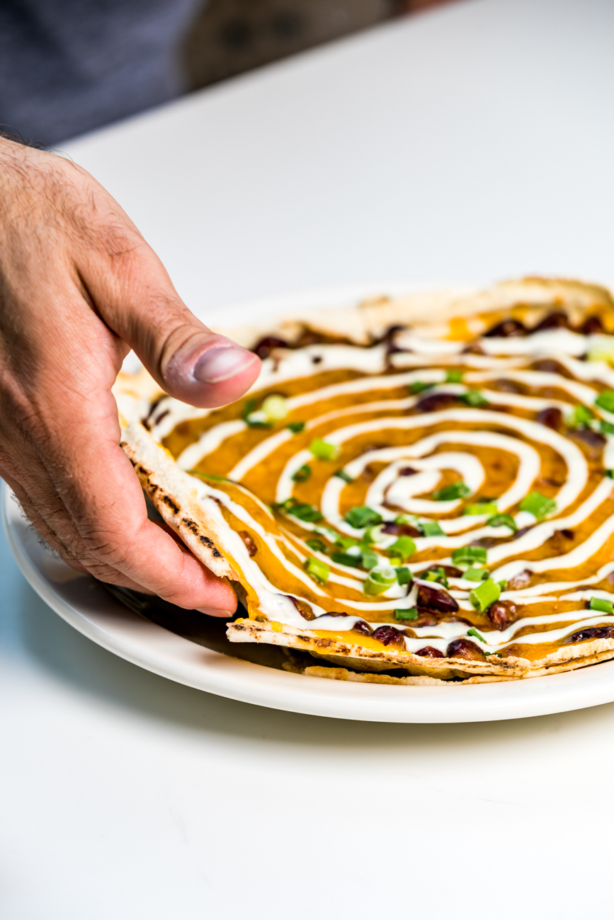 Jaffar's Pitza: Mildly spiced vegetarian chili topped with cheddar cheese, scallions, and tahini yogurt dressing / Image: Amy Elisabeth Spasoff // Published: 7.19.18<p></p>