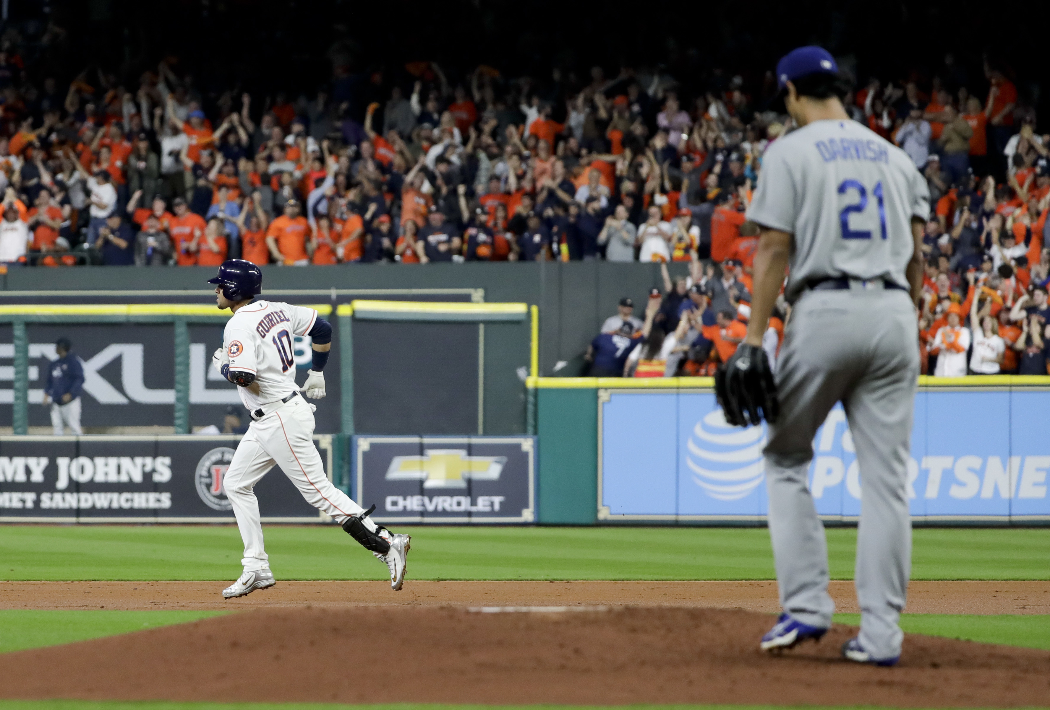 Houston Astros' Yuli Gurriel celebrates his home run past Los Angeles Dodgers starting pitcher Yu Darvish, of Japan, during the second inning of Game 3 of baseball's World Series Friday, Oct. 27, 2017, in Houston. (AP Photo/Matt Slocum)