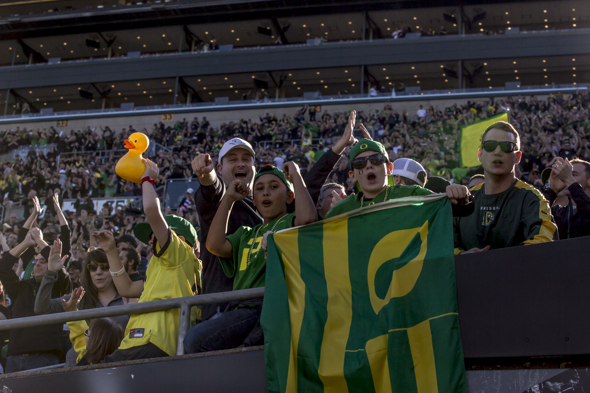 Oregon fans cheer following the Duck's first touch down. The Oregon Ducks lead the Utah Utes 17 to six at the end of the first half on a sunny afternoon at Autzen Stadium. Photo by Ben Lonergan, Oregon News Lab