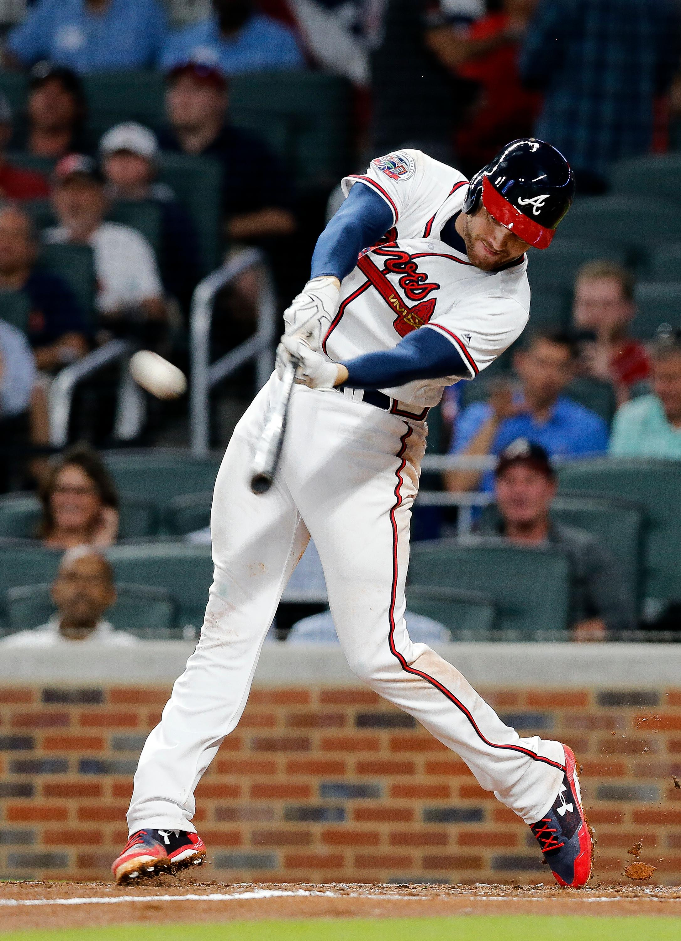 Atlanta Braves' Freddie Freeman connects on a two-run home run in the third inning of a baseball game against the San Diego Padres, Monday, April 17, 2017, in Atlanta. (AP Photo/John Bazemore)