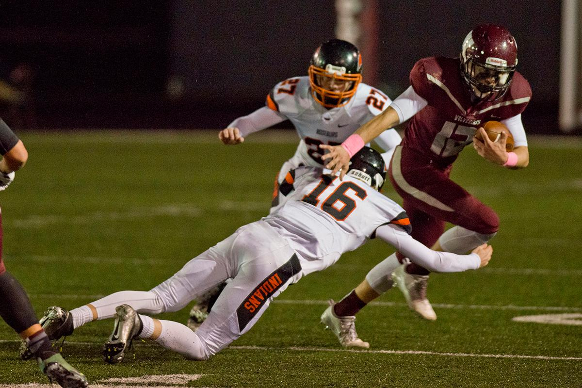 Roseburg Indians safety Collin Warmouth (#16) brings down Willamette wide receiver Griffin LaVassaur (#12). Roseburg defeated Willamette 21-20 at Wolverine stadium. Photo by Dan Morrison, Oregon News Lab