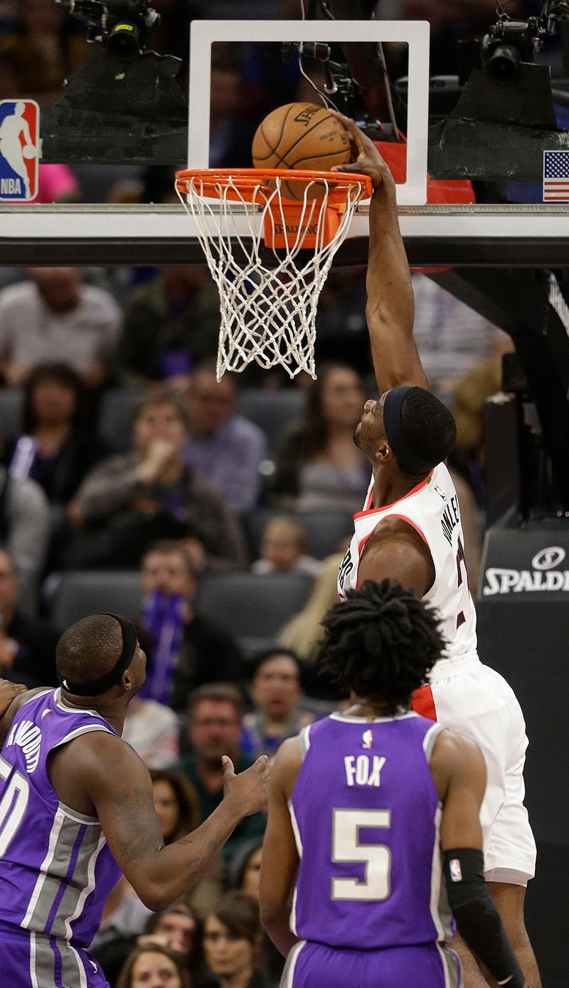 Portland Trail Blazers forward Noah Vonleh, right, goes up for a basket over Sacramento Kings' Zach Randolph, left, and De'Aaron Fox, center, during the first quarter of an NBA basketball game Friday, Nov. 17, 2017, in Sacramento, Calif. (AP Photo/Rich Pedroncelli)