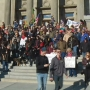 Pro-gun rights supporters march through downtown Boise