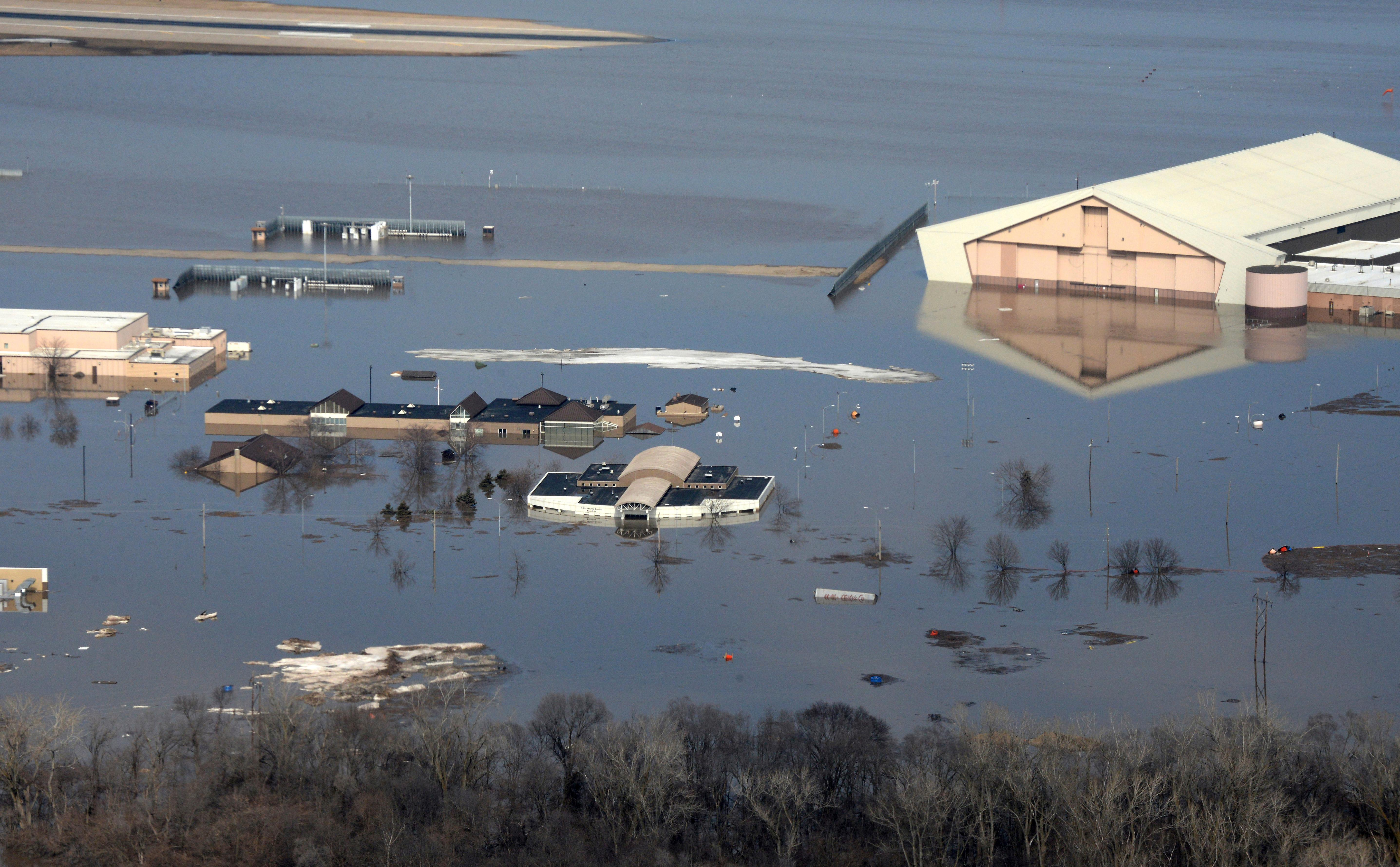 This March 17, 2019 photo released by the U.S. Air Force shows an aerial view of Offutt Air Force Base and the surrounding areas affected by flood waters in Neb. t. (Tech. Sgt. Rachelle Blake/The U.S. Air Force via AP)