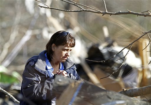 Sonja Beaty looks for family photos at the home near Crossville, Tenn., where a deadly tornado on Wednesday killed her sister-in-law Melissa Evans.
