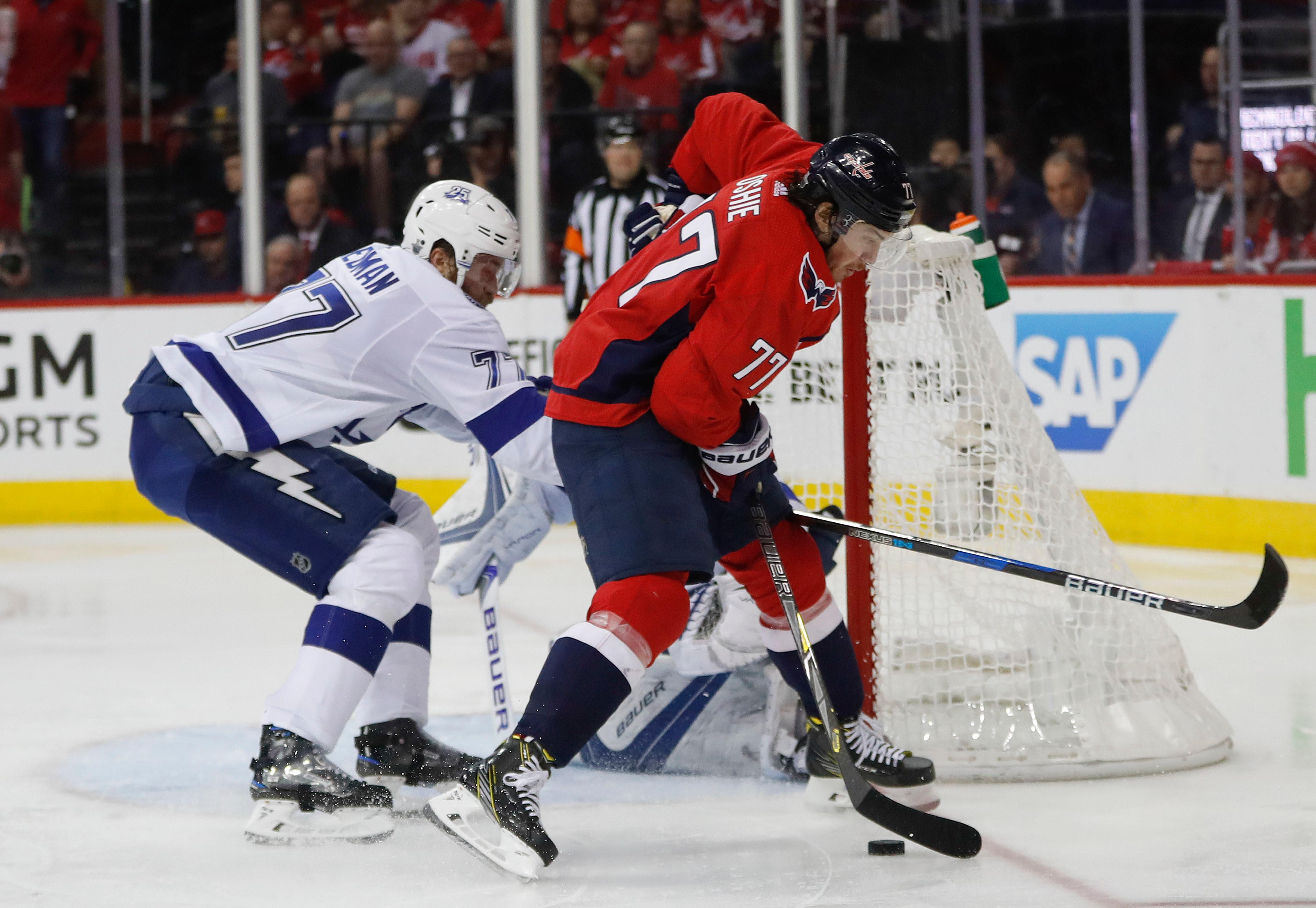 Washington Capitals right wing T.J. Oshie (77) tries to score on Tampa Bay Lightning goaltender Andrei Vasilevskiy (88), from Russia, and Lightning defenseman Victor Hedman (77), from Sweden, during the second period of Game 6 of the NHL Eastern Conference finals hockey playoff series, Monday, May 21, 2018, in Washington. (AP Photo/Pablo Martinez Monsivais)