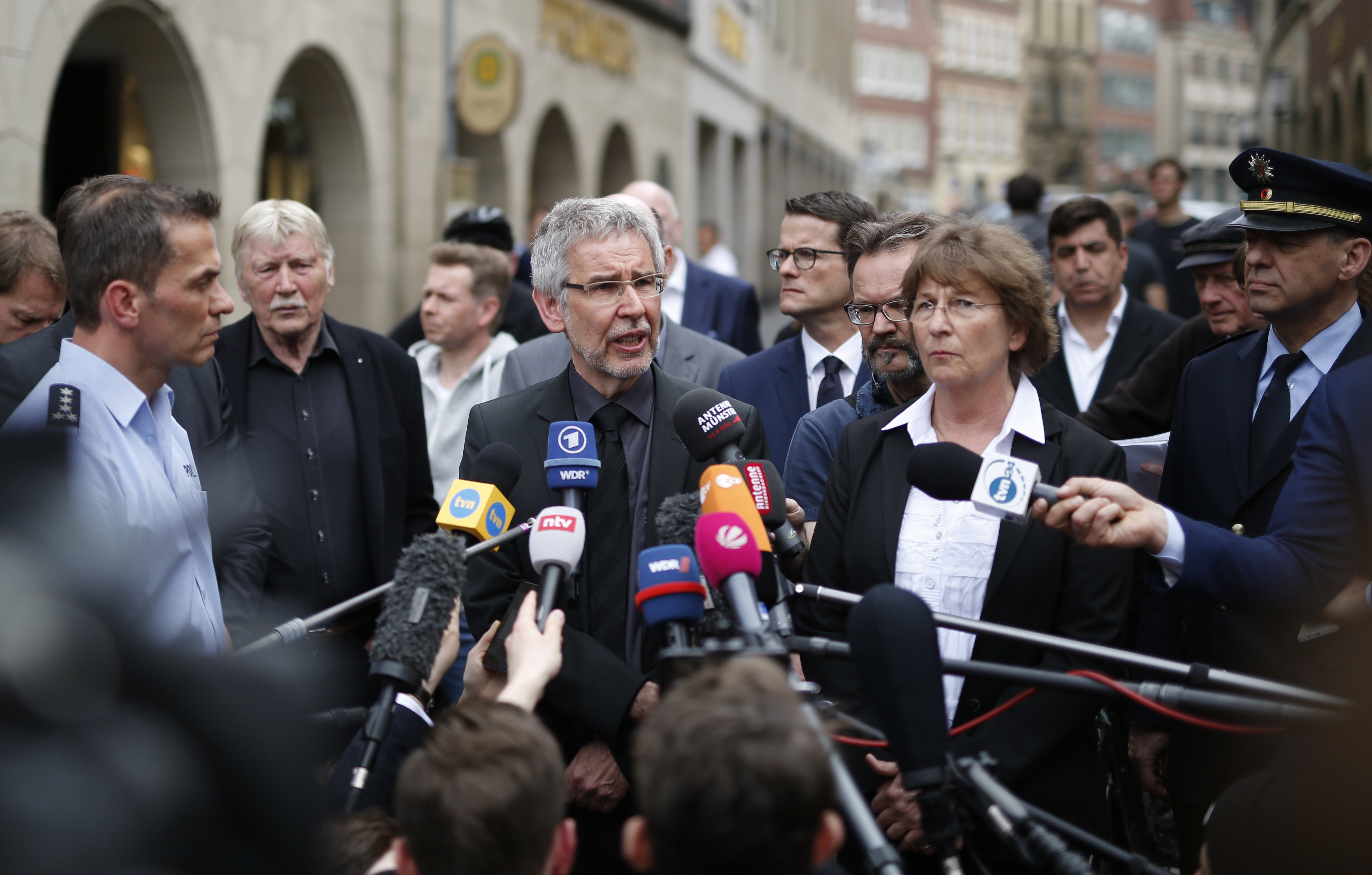 Head of police, Hans-Joachim Kuhlisch, center left, and prosecutor Elke Adomeit, center right,  give a statement in Muenster, Germany, Sunday, April 8, 2018. A van crashed into people drinking outside a popular bar Saturday in the German city of Muenster, killing two people and injuring 20 others before the driver of the vehicle shot and killed himself inside it, police said. (Ina Fassbender/dpa via AP)