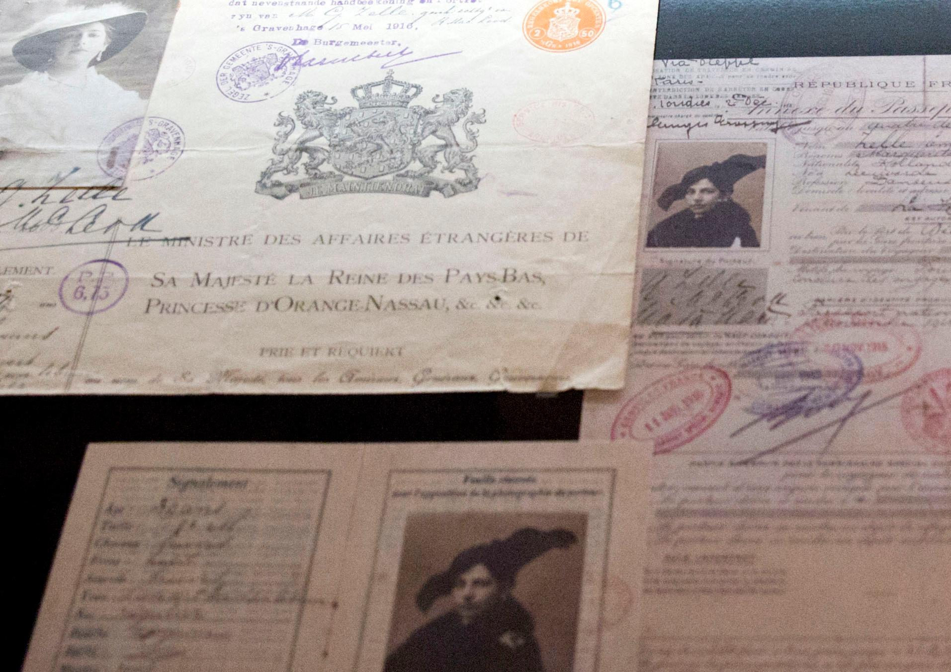 In this photo taken on Friday, Oct. 13, 2017, various identification documents of Margaretha Zelle, also known as Mata Hari, are on display at the Fries Museum in Leeuwarden, Netherlands. A century ago, on Oct. 15, 1917, an exotic dancer named Mata Hari was executed by a French firing squad, condemned as a sultry Dutch double agent who supposedly led tens of thousands of soldiers to their death during World War I. (AP Photo/Virginia Mayo)
