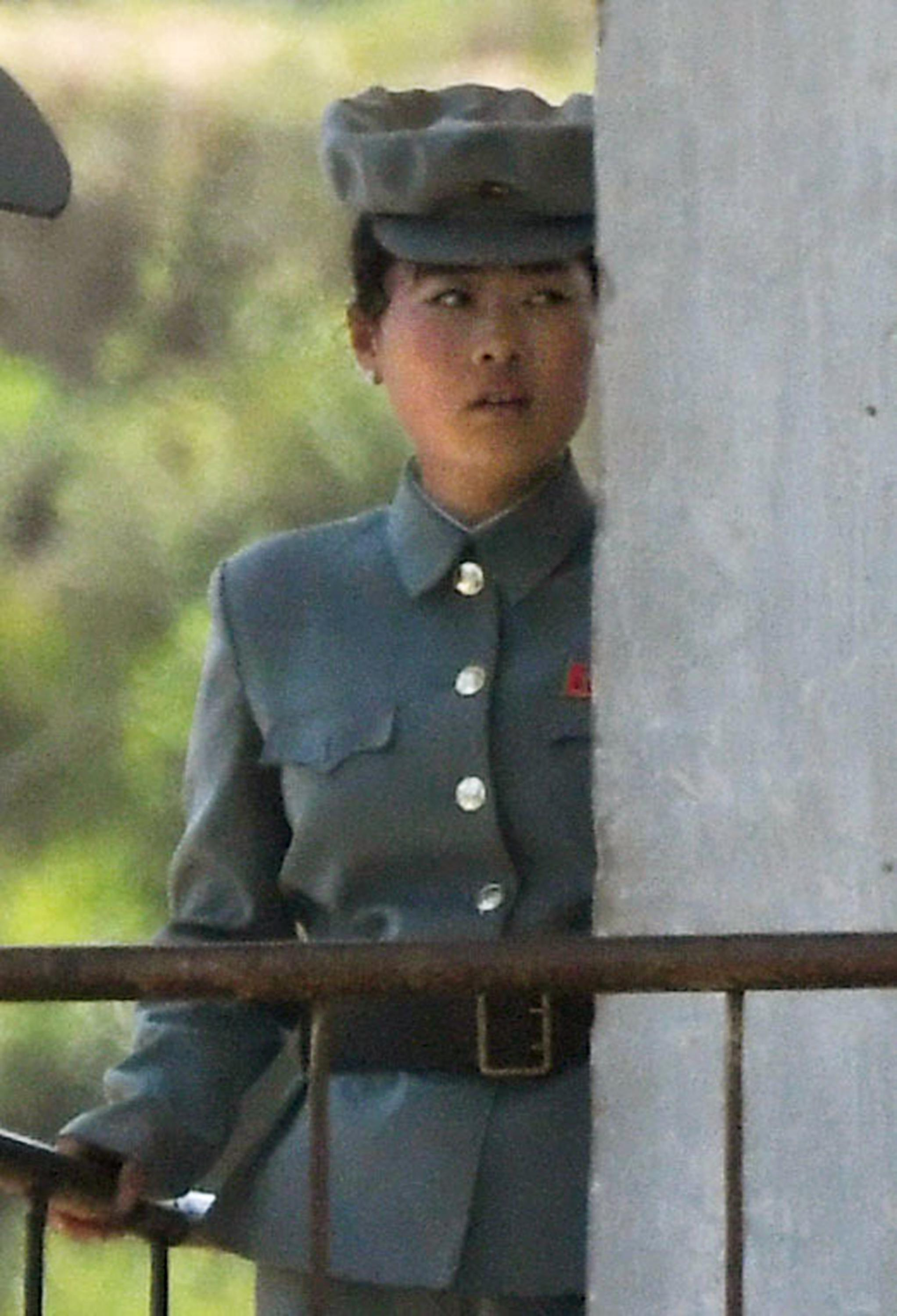 A North Korean female soldier guards the border near the Chinese border town of Dandong, northeastern Liaoning province of China Wednesday, July 5, 2017. (Minoru Iwasaki/Kyodo News via AP)
