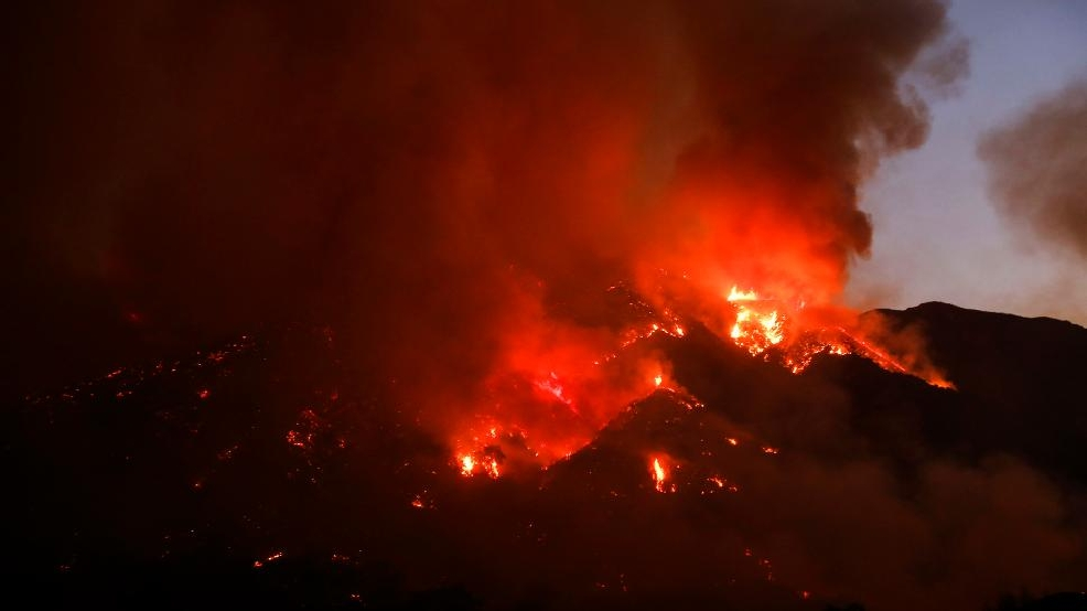 "Thousands evacuated in ""almost unprecedented"" California wildfire"