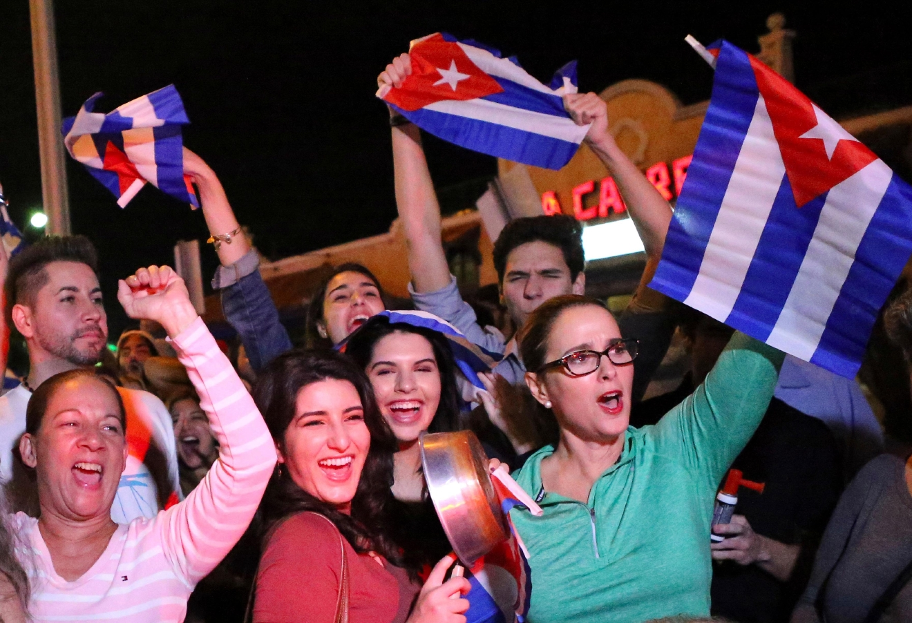 FILE- In this Nov. 25, 2016, file photo, the Cuban community in Miami celebrates the announcement that Fidel Castro died in front La Carreta Restaurant early in Miami.  (David Santiago/El Nuevo Herald via AP, File)