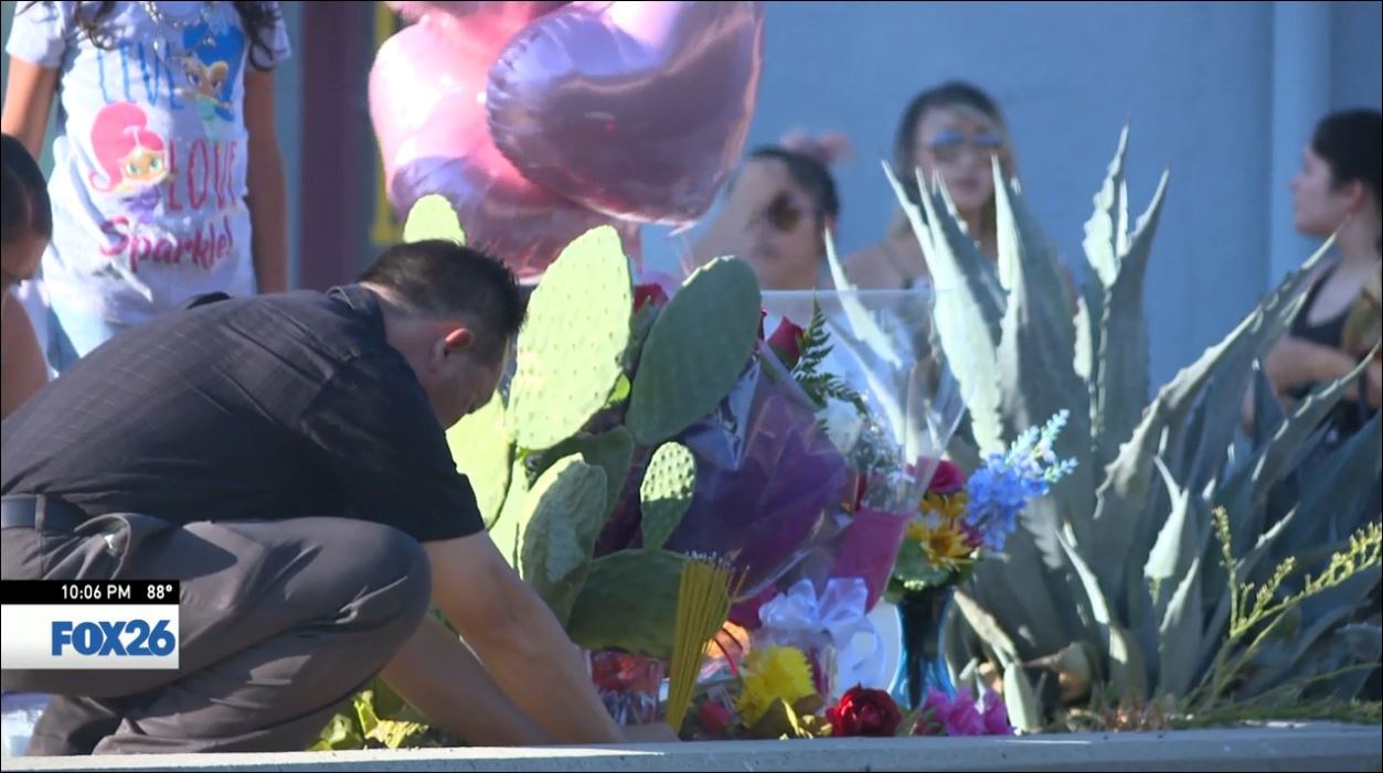 Family and friends gather at a memorial at the site Lucy's body was pulled from the canal