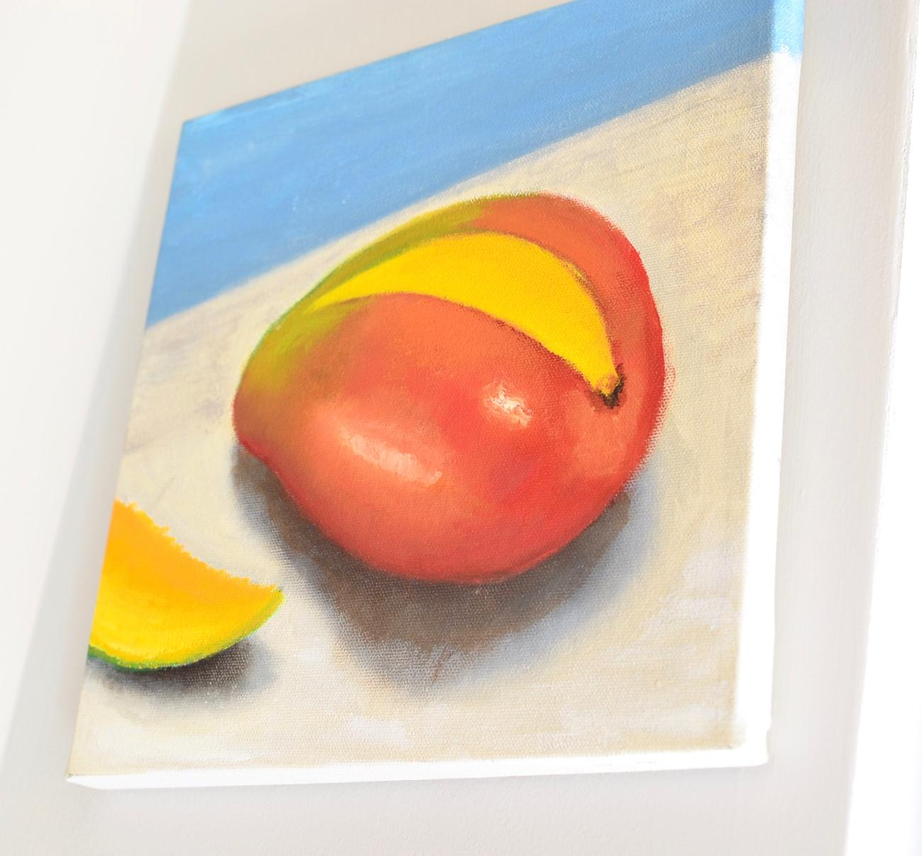 Mango oil canvas by Megan Schmitt, Amanda's sister who passed away in December 2017, hanging in the store / Image: Leah Zipperstein, Cincinnati Refined // Published: 3.10.18