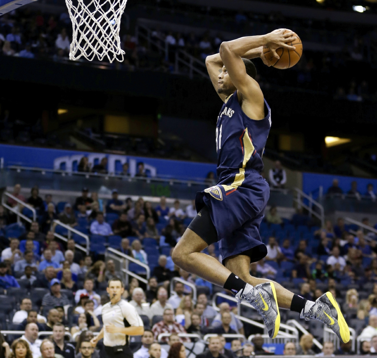 FILE - In this Oct. 21, 2015, file photo, New Orleans Pelicans' Bryce Dejean-Jones dunks the ball against the Orlando Magic during the first half of an NBA preseason basketball game in Orlando, Fla. Police say Saturday, May 28, 2016,  Dejean-Jones was fatally shot after breaking down the door to a Dallas apartment. Sr. Cpl. DeMarquis Black said in a statement that officers were called early Saturday morning and found the 23-year-old player collapsed in an outdoor passageway. He was taken to a hospital where he died. (AP Photo/John Raoux, File)