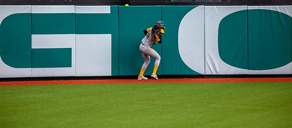 The Golden Bears' Jazmyn Jackson (#24) misses the catch as a player hits the ball over the fence. The Oregon Ducks defeated the Cal Golden Bears 2-1 in the second game of the three game series. Photo by August Frank, Oregon News Lab