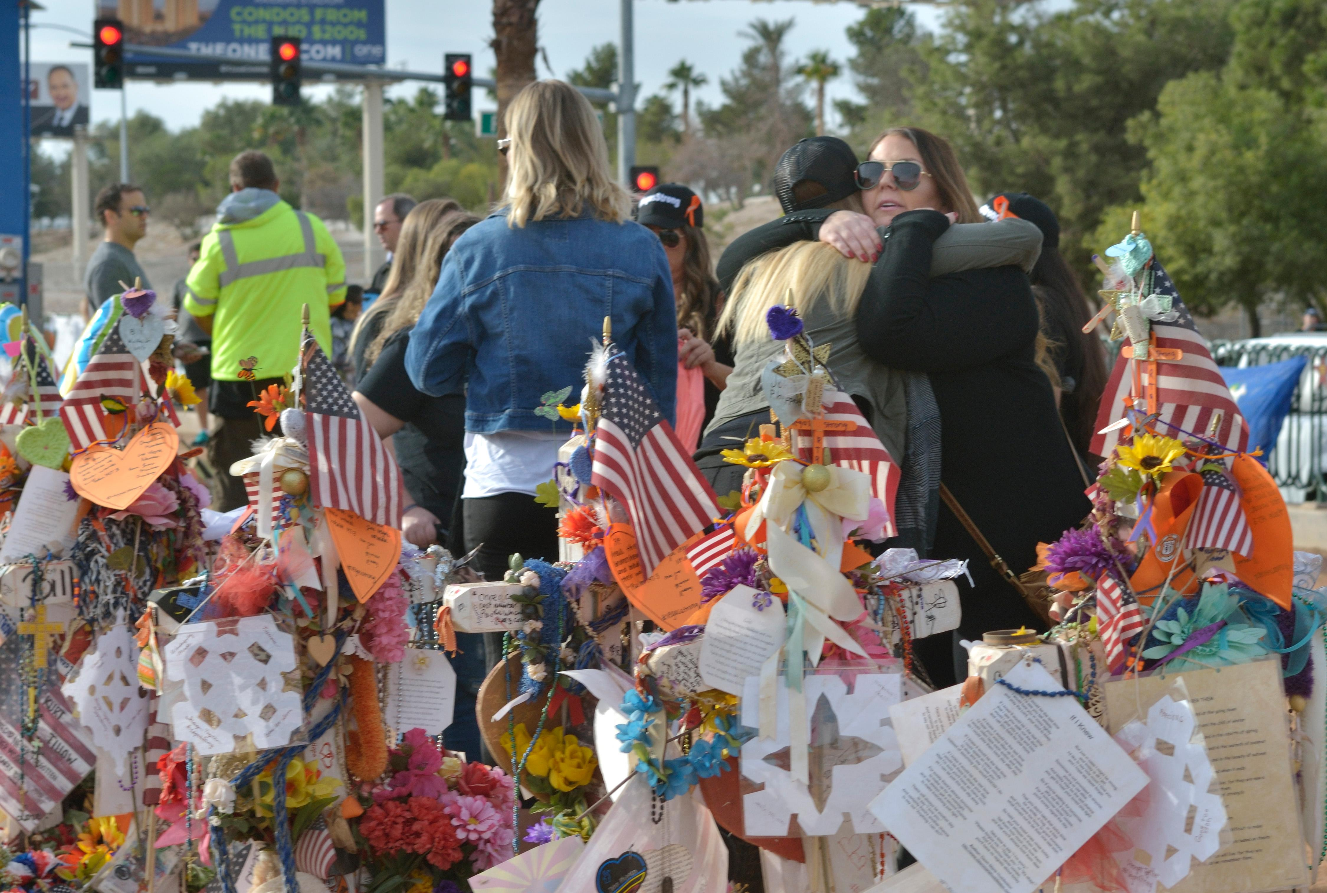 "Visitors are shown during ""Greg Zanis Day"" at the Welcome to Fabulous Las Vegas sign on the Las Vegas Strip on Sunday, Nov. 12, 2017. Zanis, a carpenter from Aurora, Ill., was recognized by the Clark County Commision for creating 58 crosses memorializing those who died during the Route 91 Harvest festival shooting on Oct. 1. The crosses were later moved to the Clark County Museum for its permanent collection. [Bill Hughes/Las Vegas News Bureau]"