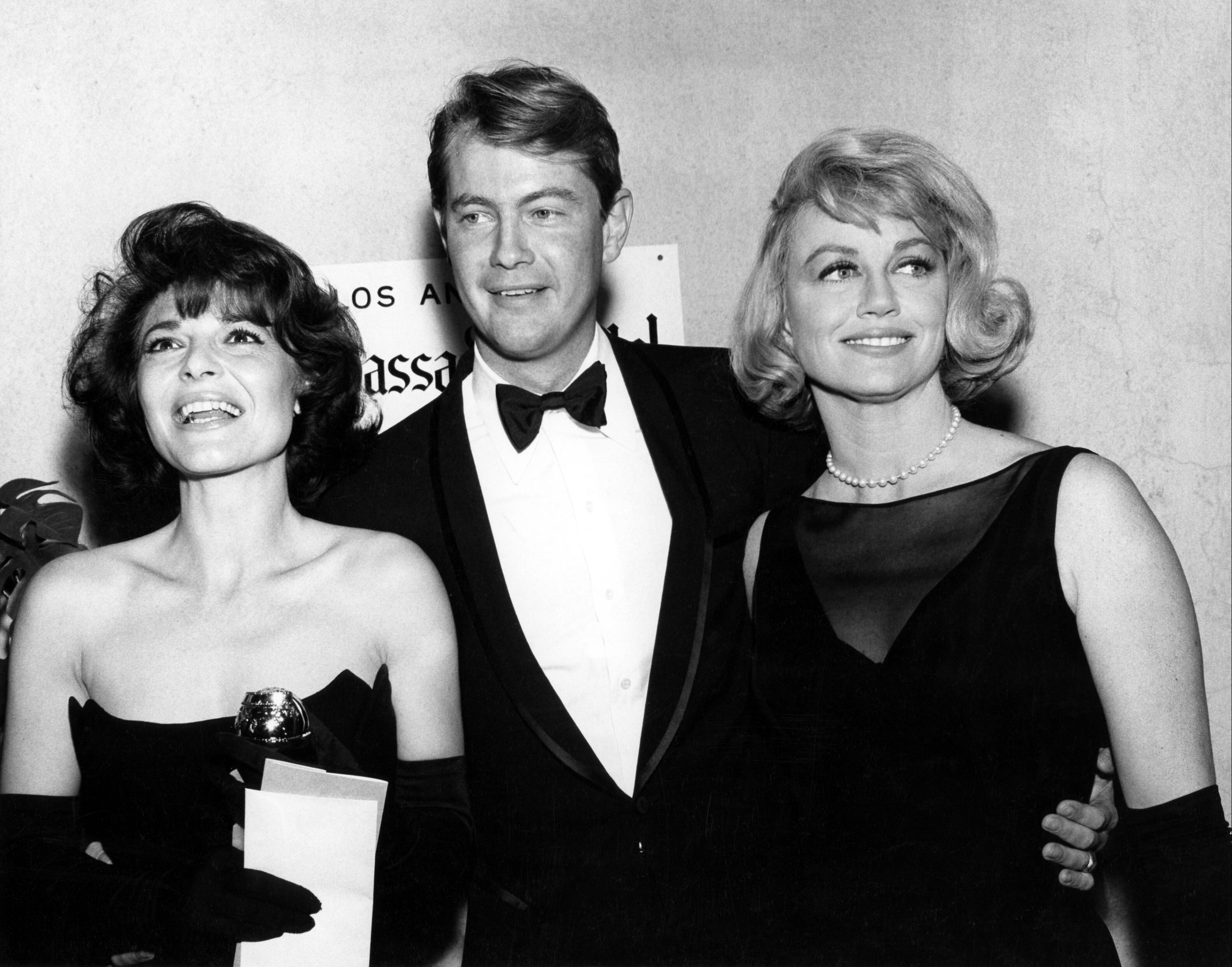 "Anne Bancroft, Troy Donahue, Dorothy Malone in 1965                  Anne Bancroft (best motion picture actress for ""The Pumpkin Eater"") with her Golden Globe.                                    Featuring: Anne Bancroft, Troy Donahue, Dorothy Malone in 1965                  When: 09 Jan 2013                  Credit: WENN.com                                    **WENN does not claim any ownership including but not limited to Copyright or License in the attached material. Fees charged by WENN are for WENN's services only, and do not, nor are they intended to, convey to the user any ownership of Copyright or License in the material. By publishing this material you expressly agree to indemnify and to hold WENN and its directors, shareholders and employees harmless from any loss, claims, damages, demands, expenses (including legal fees), or any causes of action or allegation against WENN arising out of or connected in any way with publication of the material.**"