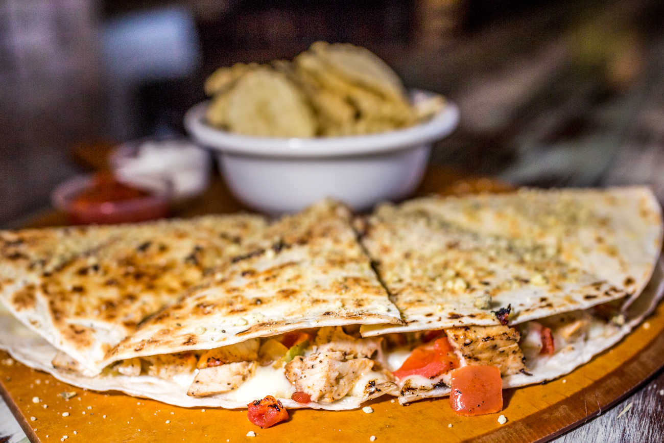 <p>Flatboat Quesadilla: fajita chicken, mozzarella cheese, tomatoes, onions, green peppers, jalapenos, and cajun seasoning / Image: Catherine Viox // Published: 9.1.19<br></p><p></p>