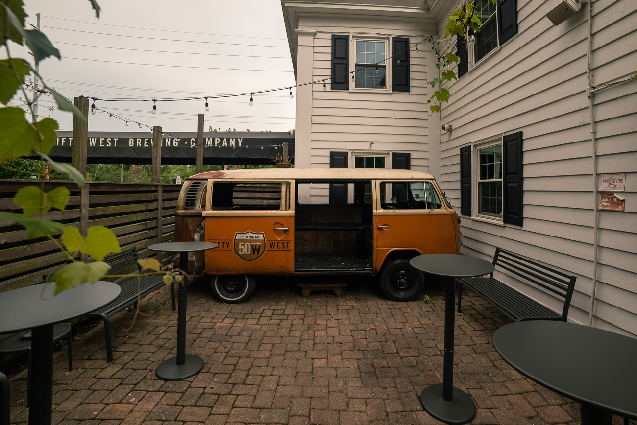 Step back into the '60s and have a craft beer while sitting in one of Fifty West's converted VW buses. / Image: Allen Meyer // Published: 9.7.18