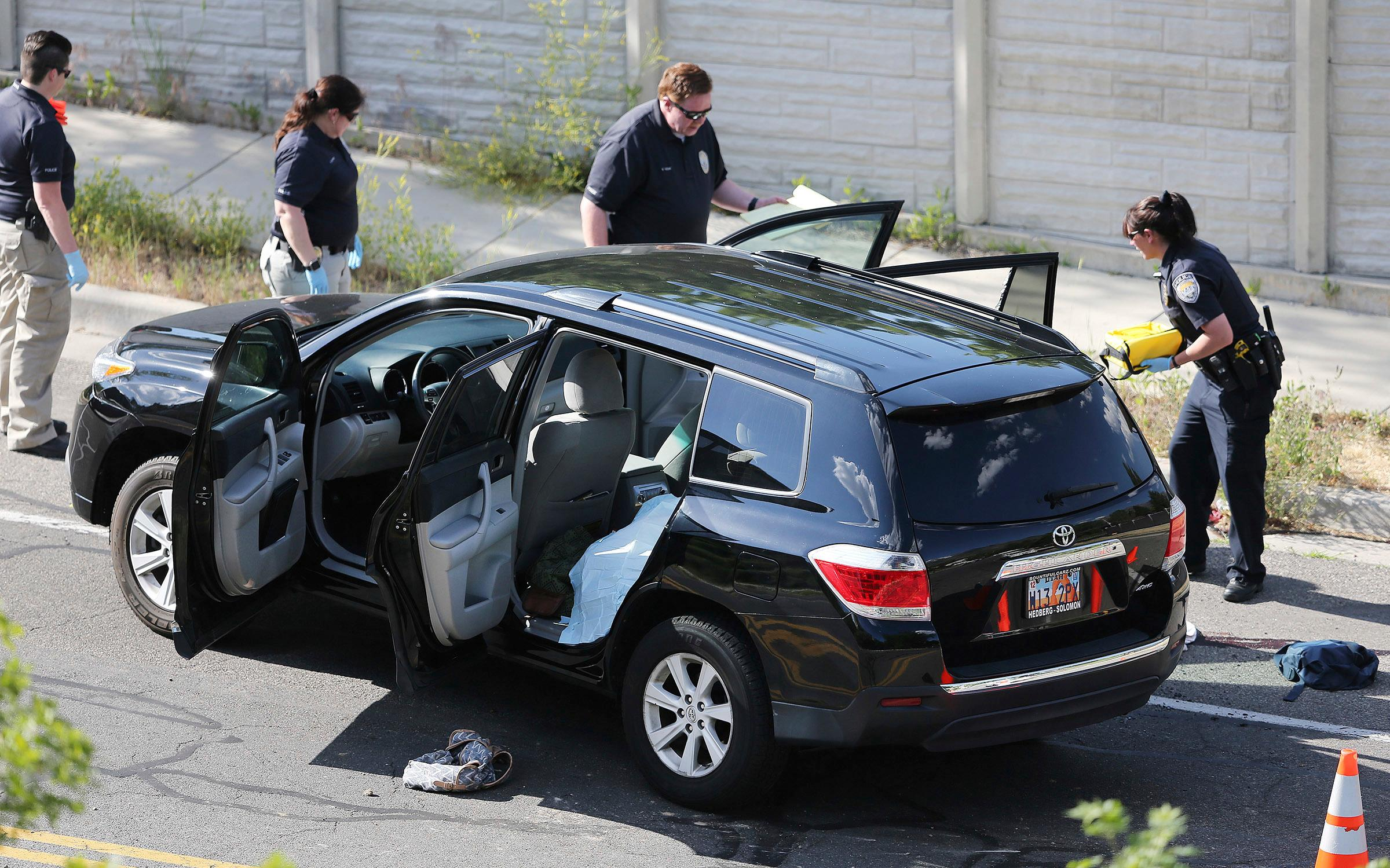 Crime scene investigators begin their work as Sandy police investigate a fatal shooting in a Salt Lake City suburb that left several people dead with another two injured, Tuesday, June 6, 2017, in Sandy, Utah. The shooting in a middle-class neighborhood in Sandy was reported to police as a domestic dispute, said Police Sgt. Jason Nielsen. (Scott G Winterton/The Deseret News via AP)