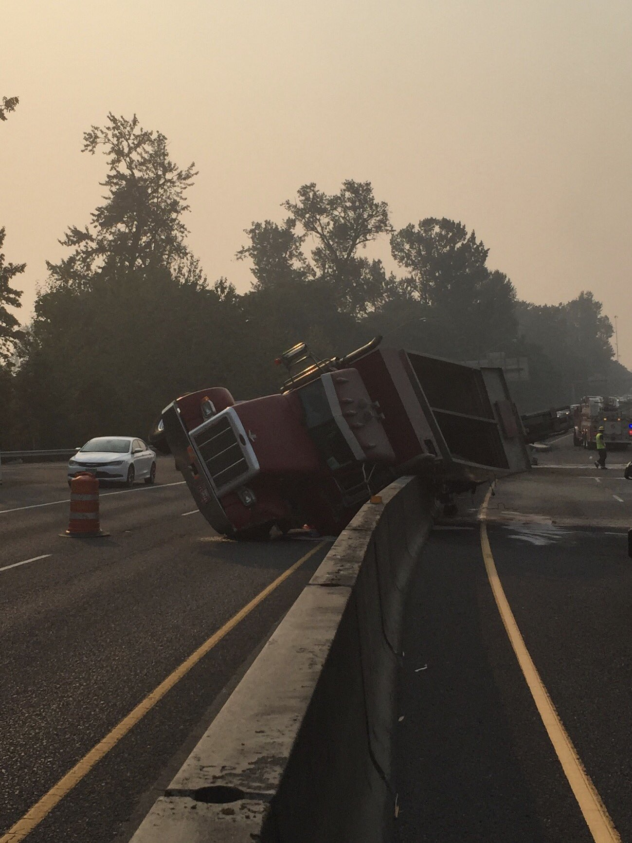 A large truck overturned on I-105 eastbound at the Coburg exit Monday evening. (Photo via Eugene Police)