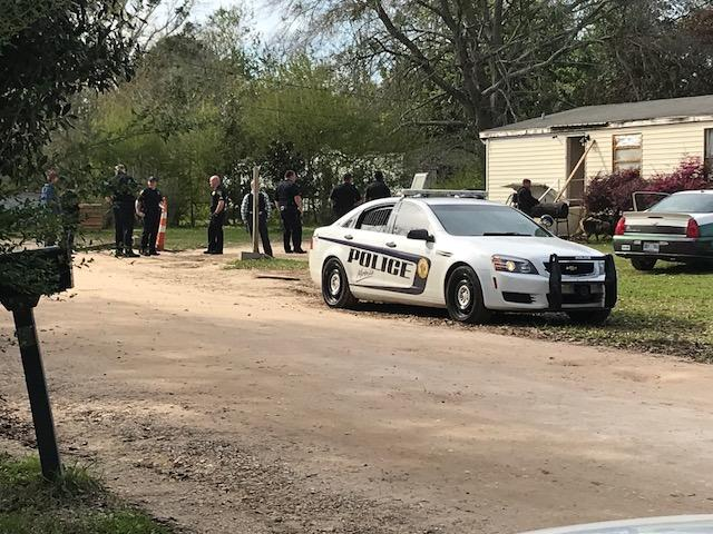 (IMAGE: WPMI) SWAT deployed to Theodore home, 2 suspects now in custody