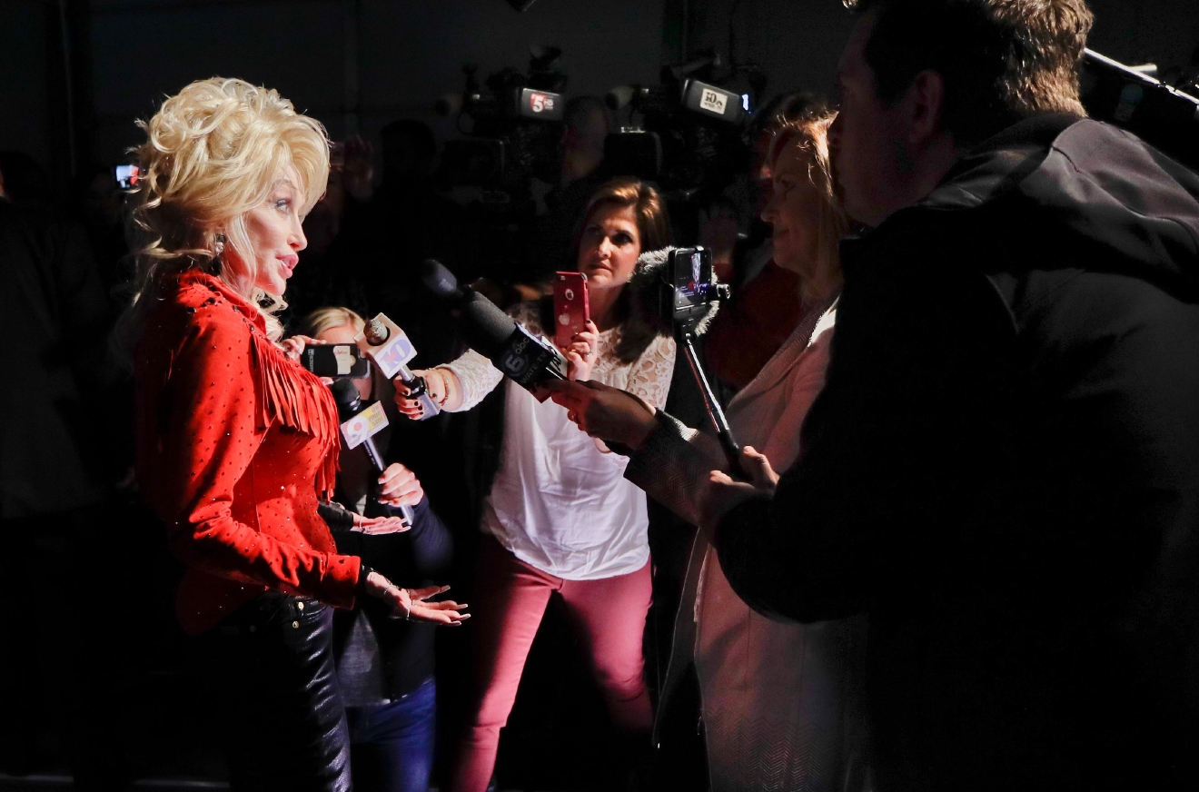 Dolly Parton is interviewed for her Smoky Mountain Rise Telethon Tuesday, Dec. 13, 2016, in Nashville, Tenn. Parton has lined up an all-star list of performers for a three-hour telethon to raise money for thousands of people whose homes were damaged or destroyed in Tennessee wildfires. (AP Photo/Mark Humphrey)