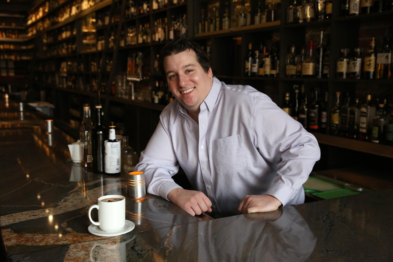 Most of us reach for the  Nyquil when we're feeling sick, but Michael Barton's method of combating a cold is a little more boozy. Barton, of Jack Rose and its underground bar, Dram & Grain, said he's been sipping on a cross between a hot toddy and a mint julep to chase away the sniffles. (Amanda Andrade-Rhoades/DC Refined)
