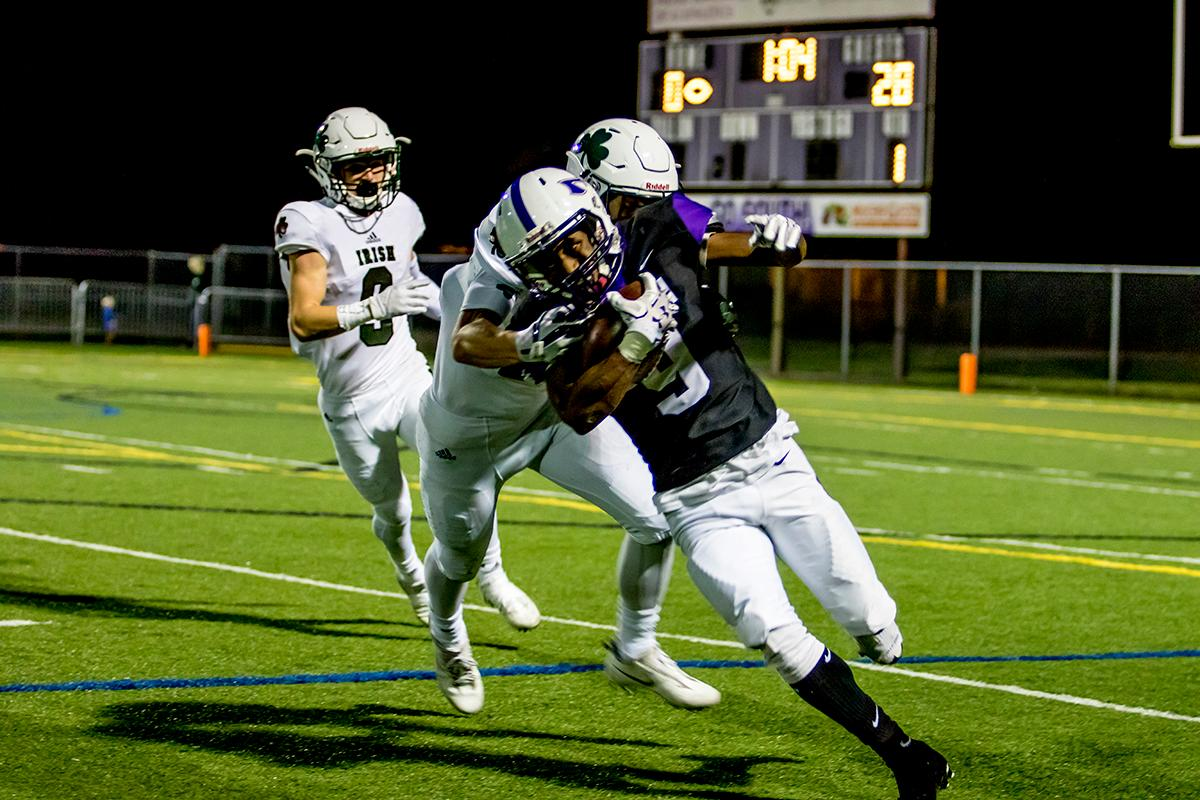 South's Kelon Logan (#9) attemps to evade Sheldon players as he moves the balll down the field. Sheldon defeated South 63-6 at South Eugene on Friday. Photo by August Frank, Oregon News Lab