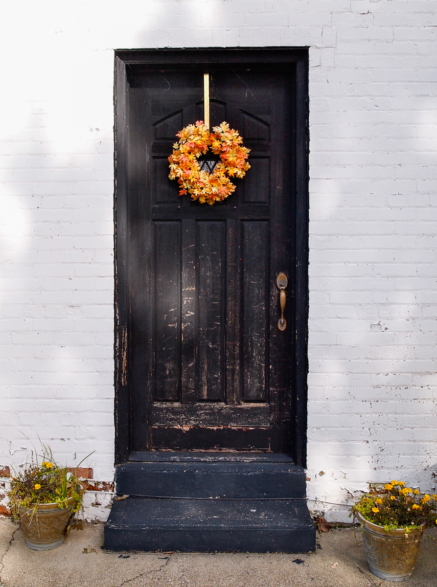 Charm around every corner. -- An old door decorated for autumn in Ripley, Ohio. (Image: Sherry Lachelle Photography)