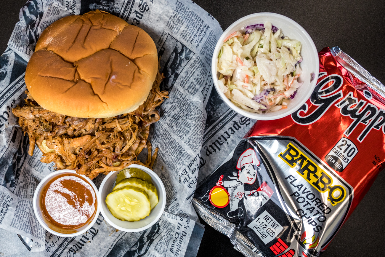 Pulled pork sandwich with house -ade sauce and slaw and served with Grippos from Riverside BBQ / Image: Catherine Viox // Published: 8.28.20